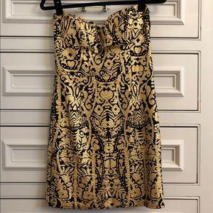 Black dress with gold foil design